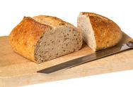 Stock Photo of artisan whole wheat bread on breadboard