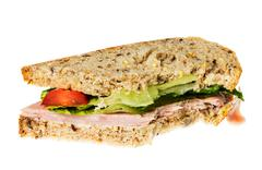 English multigrain bread ham sandwich with bite Stock Photos