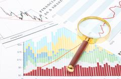 Magnifier on graphs. Stock Photos