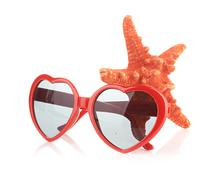 Sea star and sungasses Stock Photos