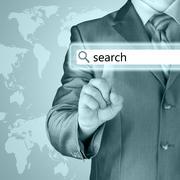 Businessman pushing virtual search bar - stock illustration