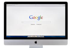Google search home page on iMac - stock photo