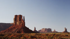 Panning wide shot of silhouetted rock formations in Monument Valley / Monument Stock Footage