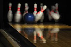 Bowling ball hit pins - stock photo