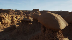 Panning medium shot of rock formations in Monument Valley / Goblin Valley State - stock footage