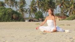 Beautiful woman sitting in meditation - stock footage