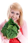 beautiful woman with fresh savoy cabbage - stock photo
