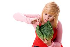 woman with fresh savoy cabbage - stock photo