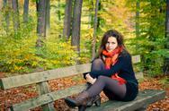 Young woman in autumn park Stock Photos