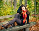 Young woman in autumn park Stock Photos
