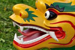 Dragon boat head on grass Stock Photos
