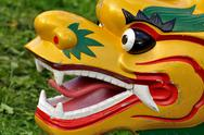Stock Photo of Dragon boat head on grass