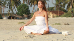 Beautiful woman sitting in meditation Stock Footage