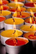 Flaming candles Stock Photos