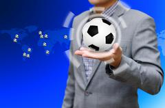 Stock Illustration of soccer game concept, ball in the hand