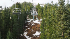 Chairlift in woods, mountains - stock footage