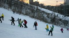 People with skateboards and ski in Protasov Yar in Kiev, Ukraine. Stock Footage