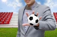 Stock Illustration of businessman invest in soccer team, football game concept