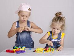two children play in the constructor - stock photo