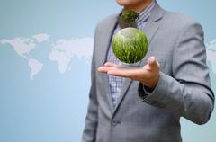Stock Illustration of green business concept, green planet on the hand