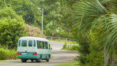 Tourist Bus Driving through a Village in Bermuda Stock Footage