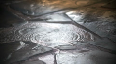Summer rain on a slate walkway slow motion Stock Footage