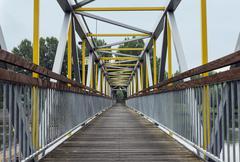 metal bridge crossing the river - stock photo