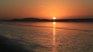Stock Video Footage of Remote Beach Sunset with receding tide