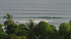 Medium high angle shot of people surfing on Esterillos Beach / Esterillos Beach, Stock Footage