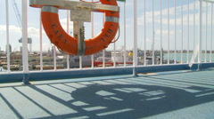 Life saving ring on ferry (dolly) entering port Stock Footage