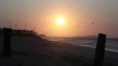 Setting sun behind brazil beach scene Stock Footage