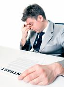 Tired businessman at the office Stock Photos