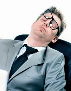 tired funny portrait of businessman at the office - stock photo