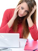 young cute woman with severe headache - stock photo