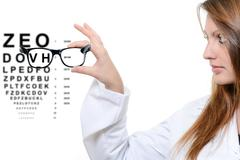 Optician giving a patient glasses to try on Stock Illustration