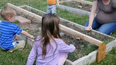 Mom And Kids Gardening 4k Stock Footage