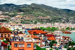 view of alanya city and harbor. turkish riviera - stock photo