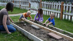 Family Pulling Weeds 4k Stock Footage