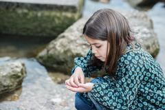 natural portrait of cute child with rocks in the background - stock photo