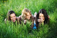Stock Photo of women grass fun