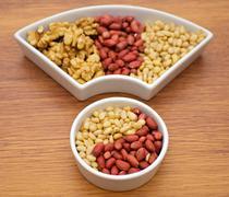 Walnuts, peanut and pine nut - stock photo