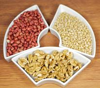 Walnuts, peanut and pine nut Stock Photos