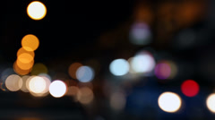 Defocused night traffic lights in Bangkok, Thailand Stock Footage