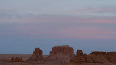 Panning wide shot of rock formations in Goblin Valley State Park / Goblin Valley - stock footage