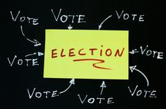 Elections text conception over black - stock photo