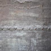 black metal plate or armour texture with rivets - stock photo