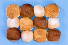 Variety of hamburger buns isolated on blue Stock Photos