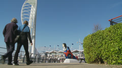Couple walk in Portsmouth (Spinnaker Tower in background) Stock Footage