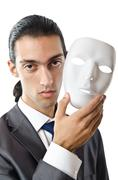 Industrial espionage concept with masked businessman Stock Photos