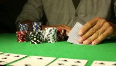 Anonymous poker player going all in Stock Footage